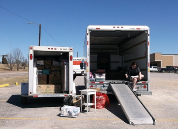 Unpacking the trailer into the Uhaul truck.